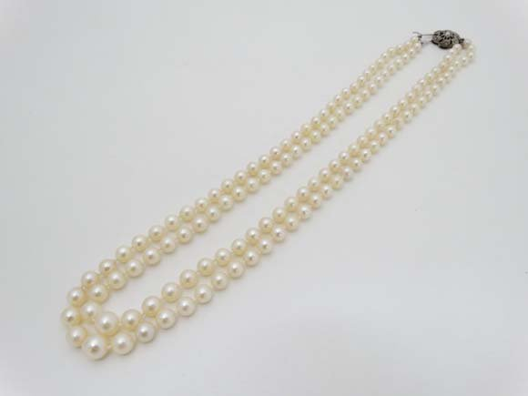 A 2- strand necklace of graduated pearls with Sterling