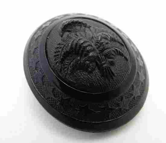 A Victorian Whitby jet brooch of oval form with fern