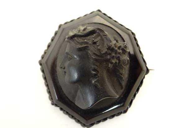 A Victorian Whitby jet brooch of octagonal form with
