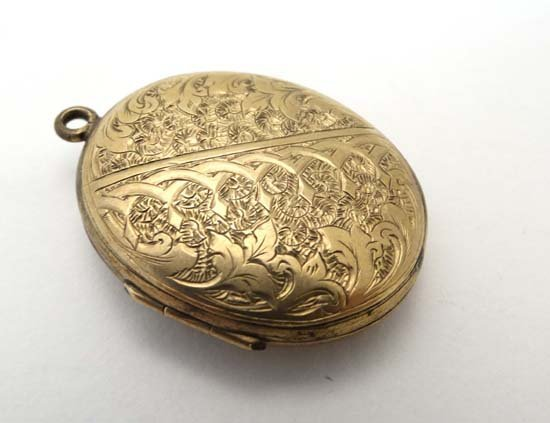 A Victorian gilt metal double locket with engraved