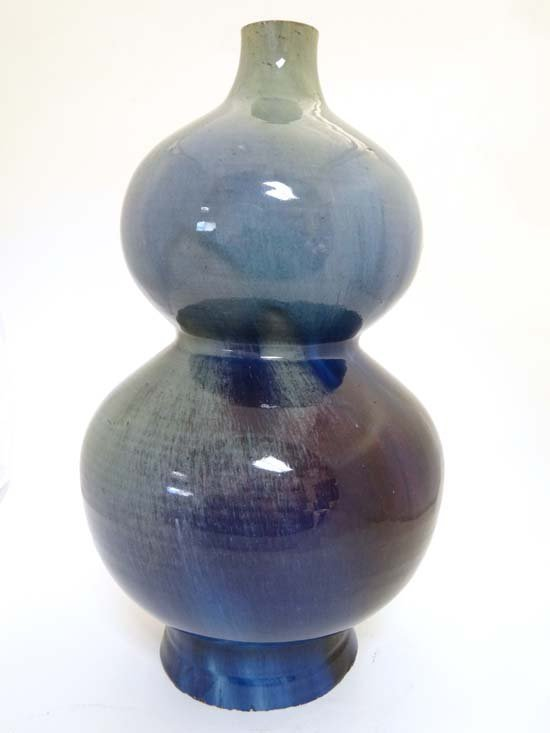 A large reduced flambé-glazed double-gourd vase China ,
