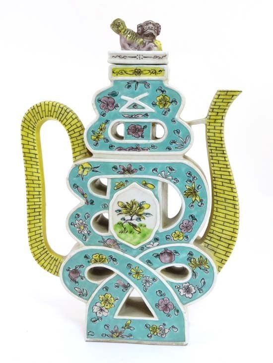 A famille-verte reticulated biscuit ewer and cover