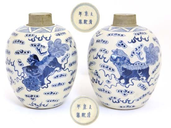 A pair of oval blue and white vases China , Kangxi mark