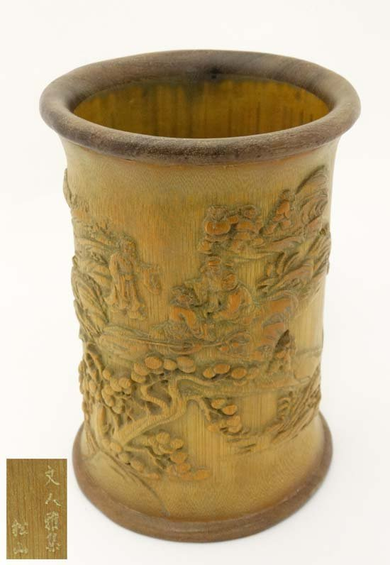 A carved bamboo brush pot China , 20th century With
