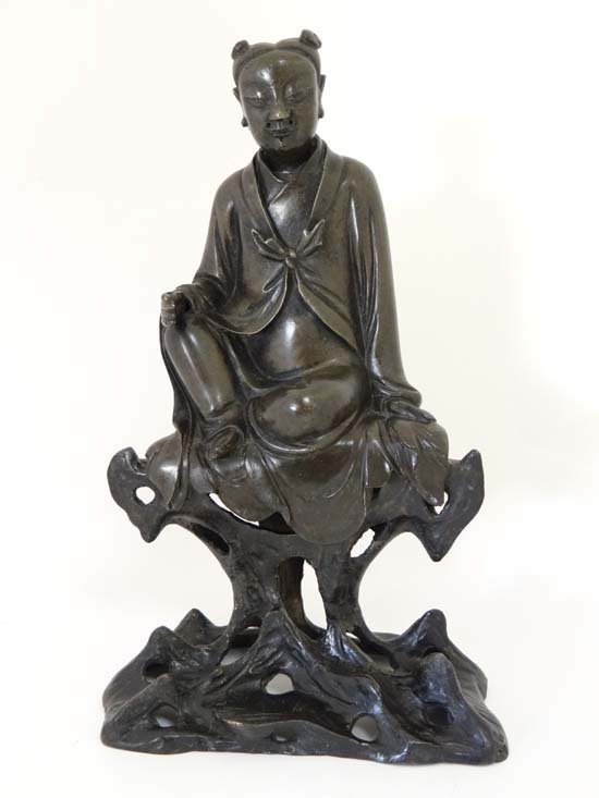 A large bronze figure of a youth China , Ming Dynasty