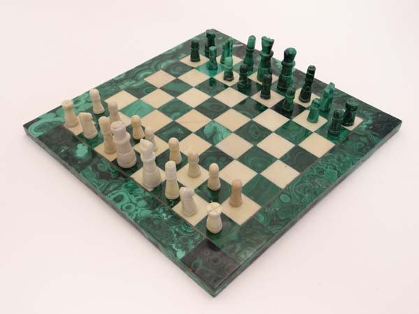 A Malachite and alabaster chess board and chess pieces.