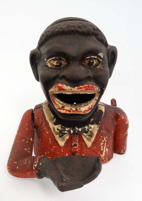 A '' Jolly Nigger '' Cast Iron money box. 6 1/2'' high.