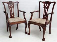 A pair of superb mahogany desk chairs each with