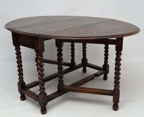 A 1920' oval oak gateleg table with barley twist - 2