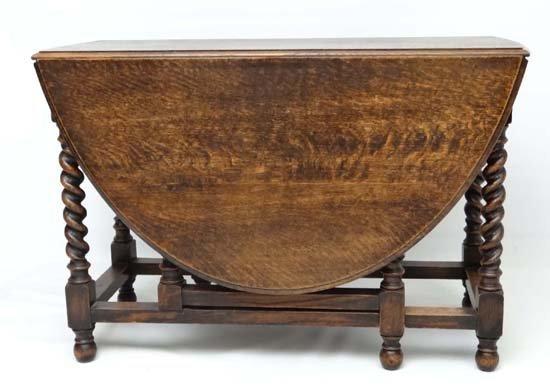 A 1920' oval oak gateleg table with barley twist - 4