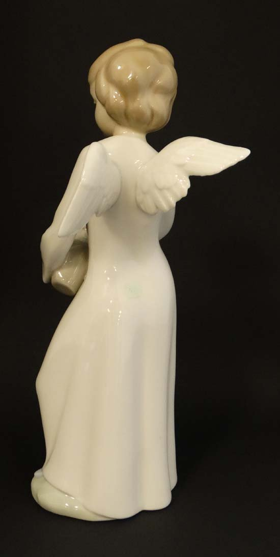 A Nao by Lladro '' Angel'' figurine. Factory marks to - 4