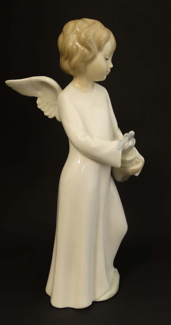A Nao by Lladro '' Angel'' figurine. Factory marks to - 5