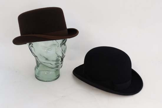 A Brown wool flat top bowler hat by Lock and Co .
