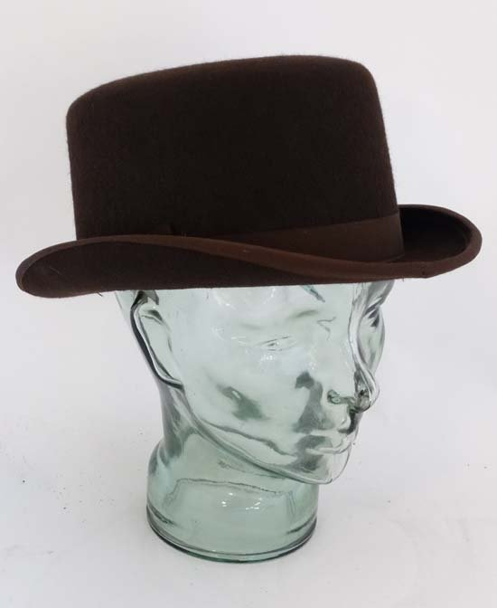 A Brown wool flat top bowler hat by Lock and Co . - 3