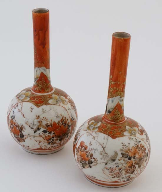A pair of small Japanese Kutani bottle vases. Decorated