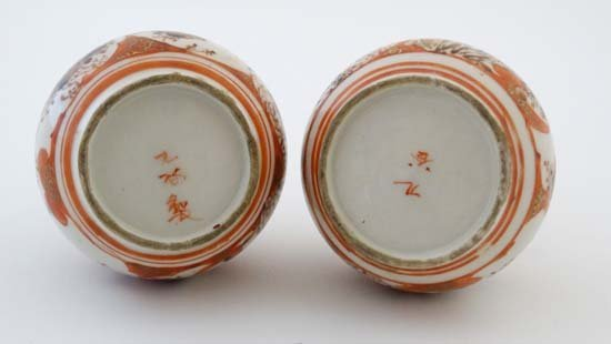 A pair of small Japanese Kutani bottle vases. Decorated - 2