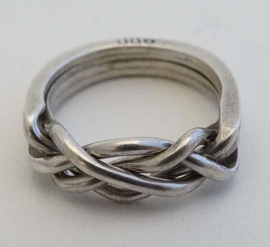 A .800 white metal puzzle ring / Turkish wedding ring