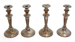A set of 4 Old Sheffield Plate candlesticks with floral