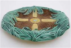 A late 19thC Majolica bread dish, decorated with corn