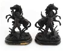 Two  black painted spelter Continental figure groups