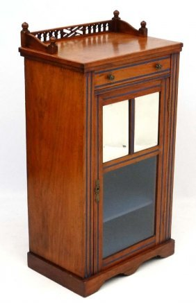 An Edwardian Mahogany Music Cabinet With Bevelled Glass