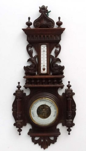 Barometer: A Carved Wood Surround With Dolphins Aneroid