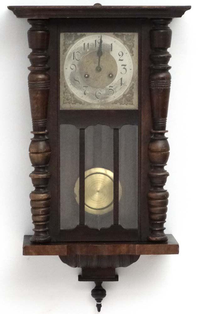 Clock : an early 20 thC Walnut cased 8 day Wall clock