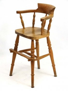 A 20thc Blonde Oak Childs High Chair Formed As A Small