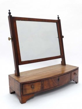 A Late Regency Mahogany Bow Front Toilet Mirror With 3