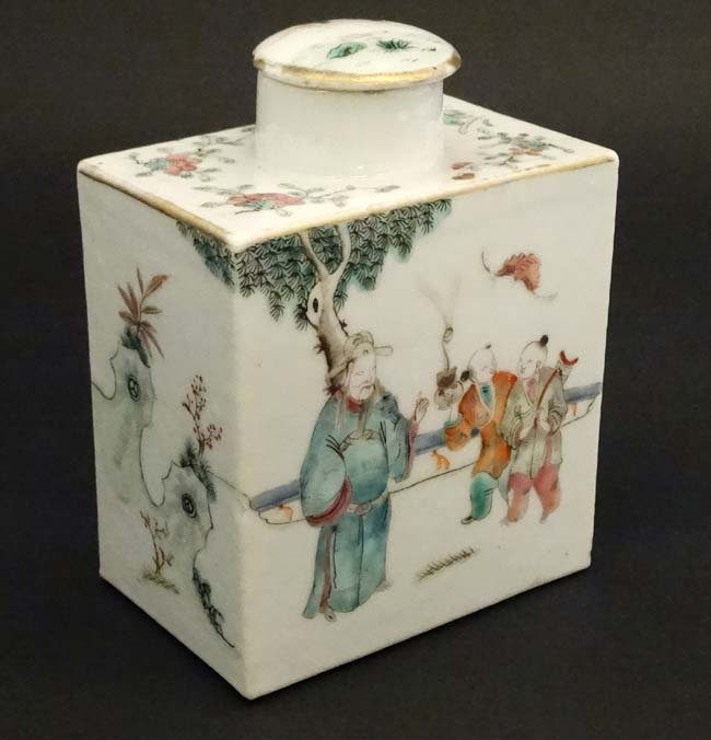 A Chinese famille rose tea caddy decorated in