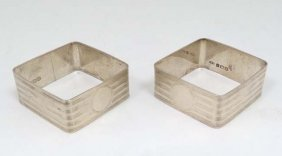 A Pair Of Art Deco Silver Napkin Rings Of Squared Form