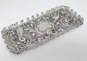 A Victorian Silver Tray With Embossed Floral, Scroll