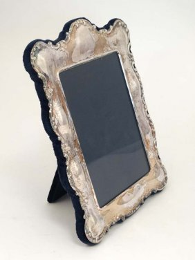 A Photograph Frame With Silver Plated Surround. The