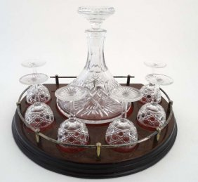 A Lead Crystal Ship's Decanter Together With 6 Pedestal