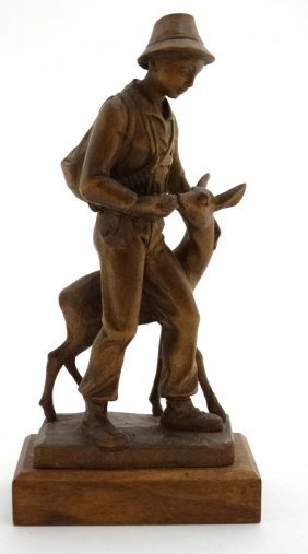 A C.1900 Swiss Carved Wooden Figure Group Of A Young