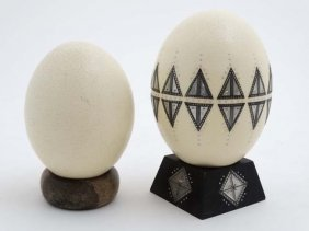 Two Ostrich Eggs One With Applied Decoration And Approx
