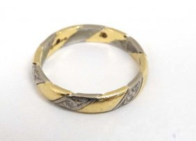 An 18ct Ring, The Yellow And White Gold Banding Set