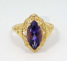 A Silver Gilt Ring Set With Central Amethyst. Marked '
