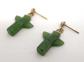 A Pair Of Gilt Metal Drop Earrings Set With Carved Jade