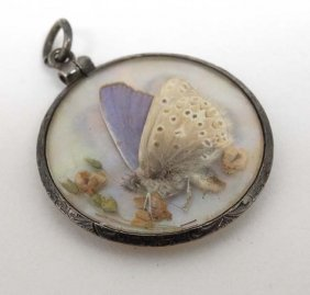 A Double Sidled Glazed Pendant Locket With White Metal