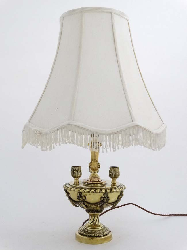 A mid 20thC brass and copper table lamp in the