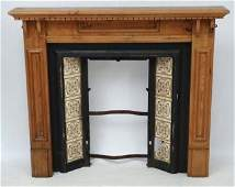 A Victorian cast iron fire surround and tile insert