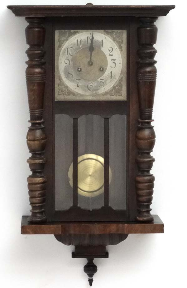 Clock : an early 20 thC Walnut cased 8 day Wall clock