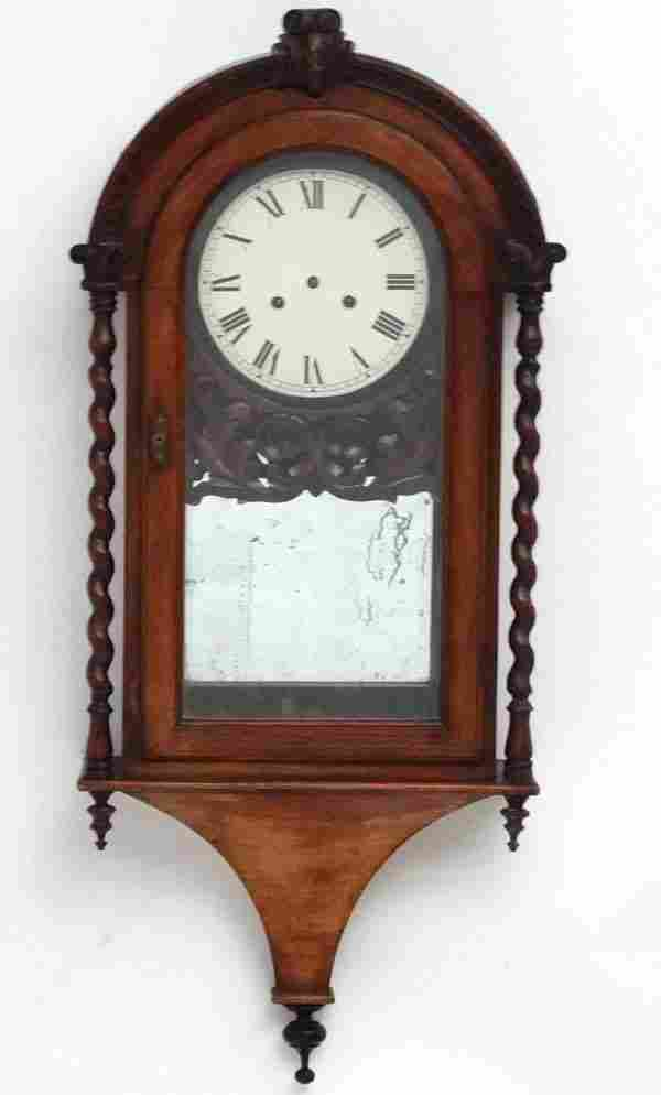 Clock : a 19 thC Rosewood cased arch topped wall clock,