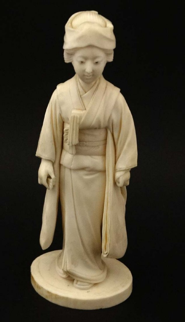 A Japanese Ivory Meiji okimono of a female figure