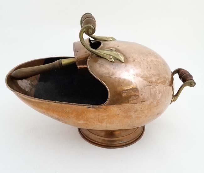 A 19thC copper and brass helmet shaped coal scuttle