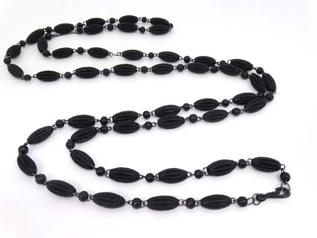 A Victorian Whitby jet bead longuard approx. 56'' long - 2