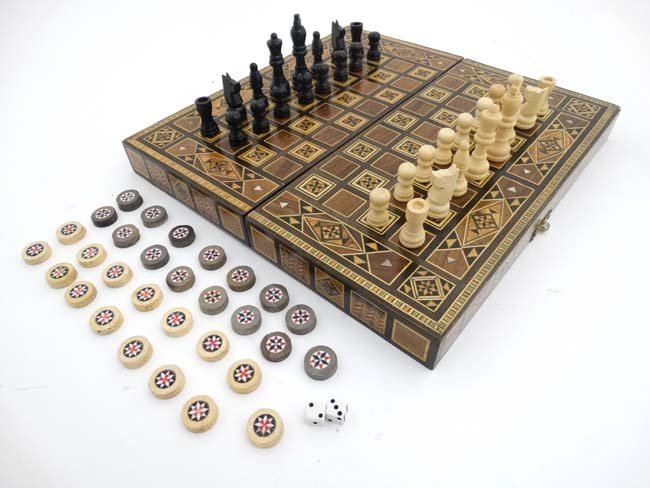 A mid 20thC Damascus folding chess and backgammon board