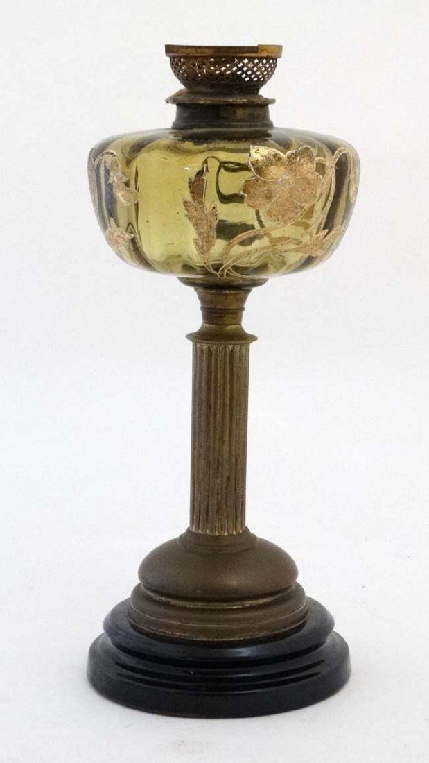An unusual oil lamp with reeded column, circular base