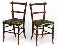 A pair of Victorian faux rosewood boudoir chairs with